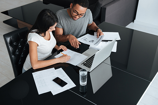 Couple reviewing tax documents